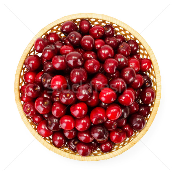 Top view of sweet cherry berries (Prunus avium) in wicker plate Stock photo © erierika