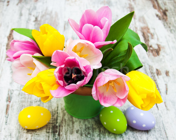 Bucket with colorful tulips and easter eggs Stock photo © Es75