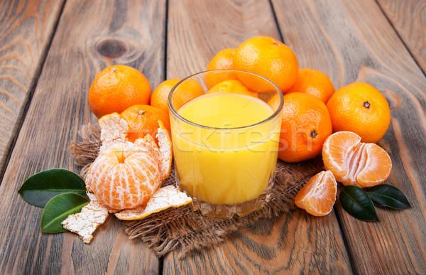 Fresh citrus juice and tangerines Stock photo © Es75