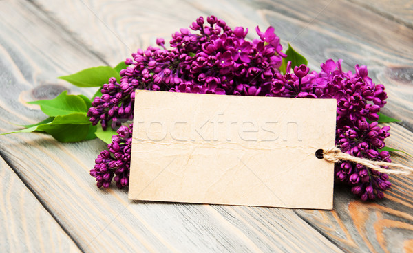 Lilac flowers with empty tag Stock photo © Es75