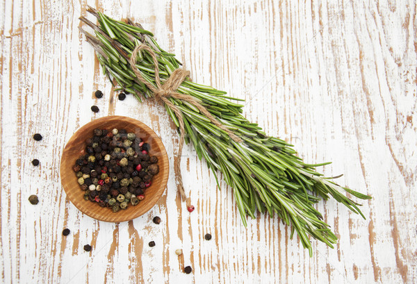 Rosemary and peppercorns Stock photo © Es75