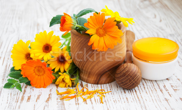 Calendula flowers and mortar Stock photo © Es75