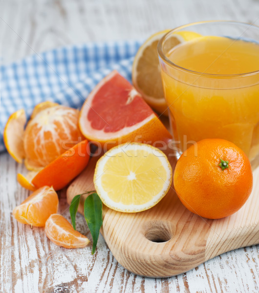 Citrus fruits and fresh orange juice Stock photo © Es75