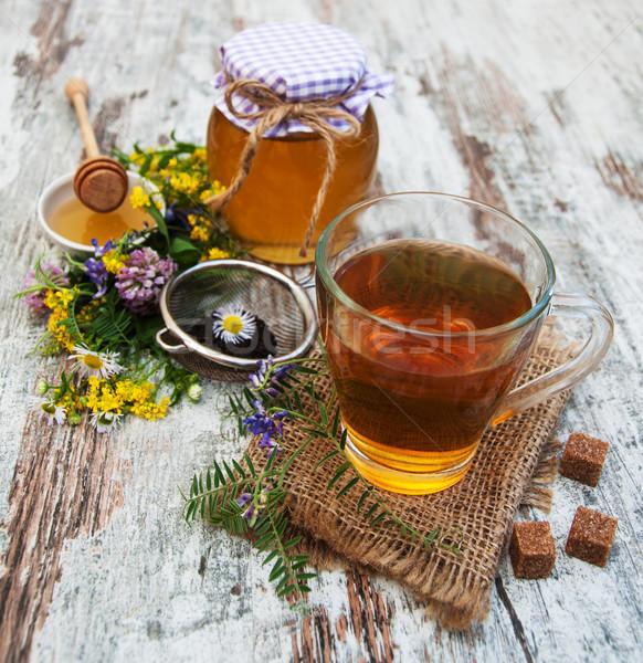 Copo chá mel flores velho Foto stock © Es75