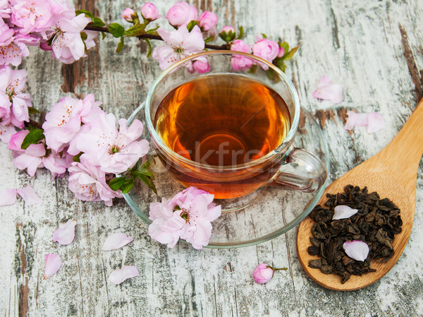 Cup of tea and sakura blossom Stock photo © Es75