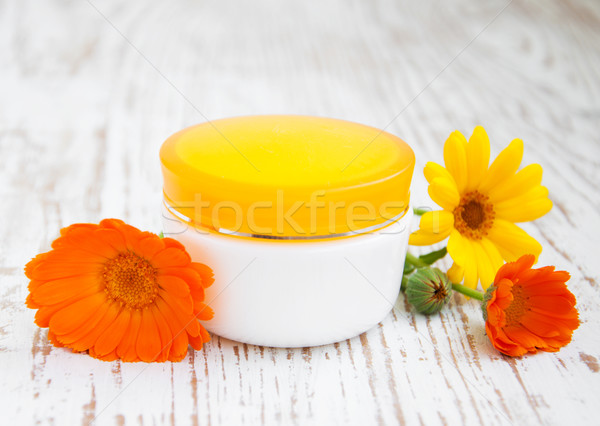 Face cream and calendula flowers Stock photo © Es75