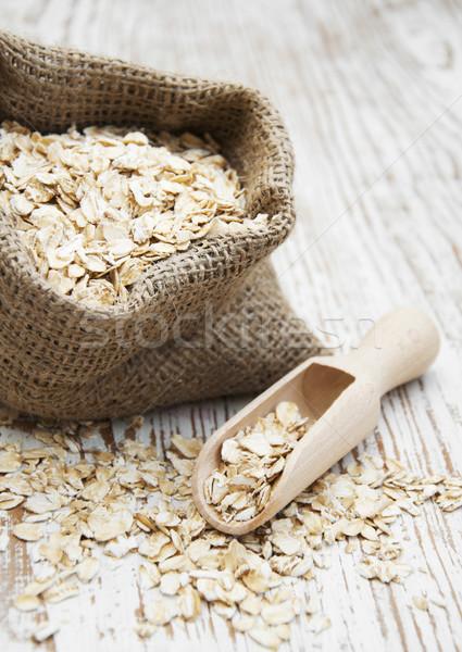 Zab pelyhek kicsi zsákvászon zsák fából készült Stock fotó © Es75
