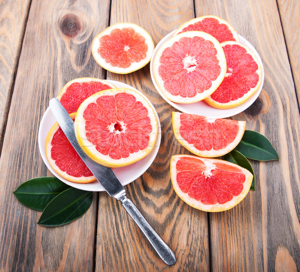 Grapefruits with knife Stock photo © Es75