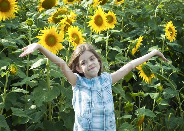 Stock photo: Beautiful child with sunflower