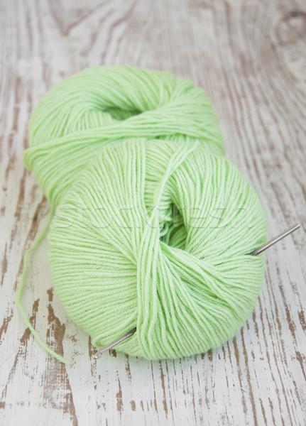 Green yarns and crotchet hook Stock photo © Es75