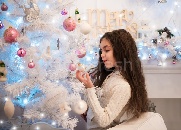little girl decorating christmas tree Stock photo © Es75