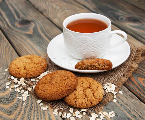 Csésze tea kása sütik fából készült háttér Stock fotó © Es75