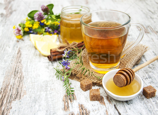 Cup of tea, honey and flowers Stock photo © Es75