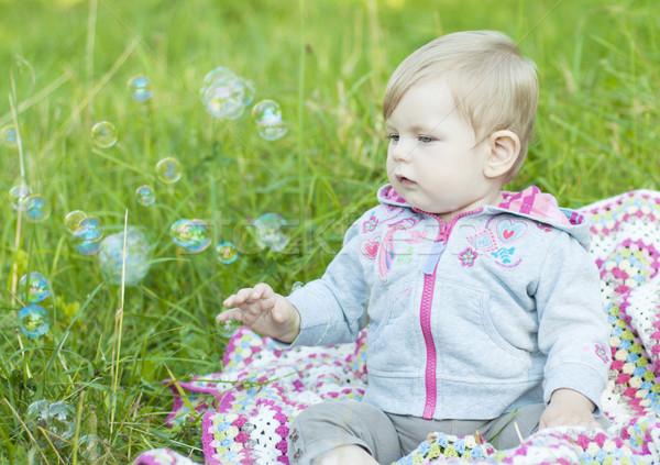удар пузырьки Cute девушки парка ребенка Сток-фото © Es75
