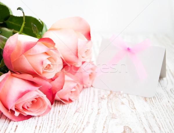 Boş kart mesaj pembe güller ahşap kâğıt Stok fotoğraf © Es75
