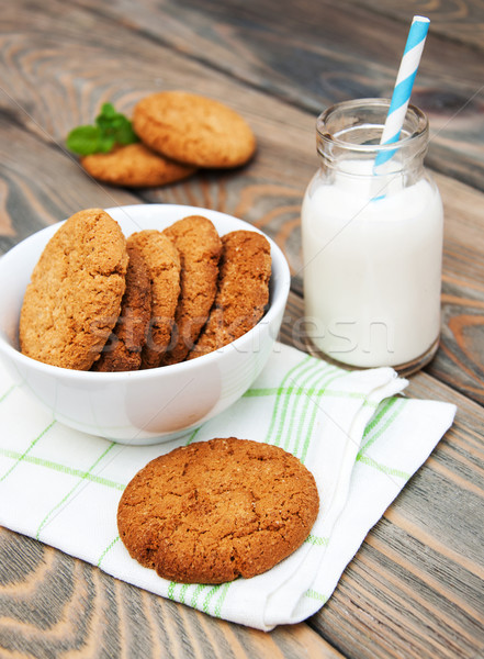 Milk and oatmeal cookies Stock photo © Es75