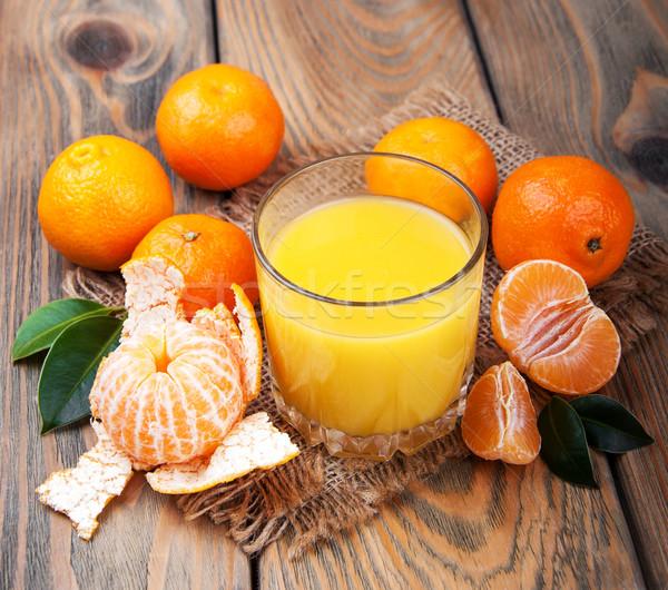 Taze narenciye meyve suyu turuncu eski ahşap masa Stok fotoğraf © Es75