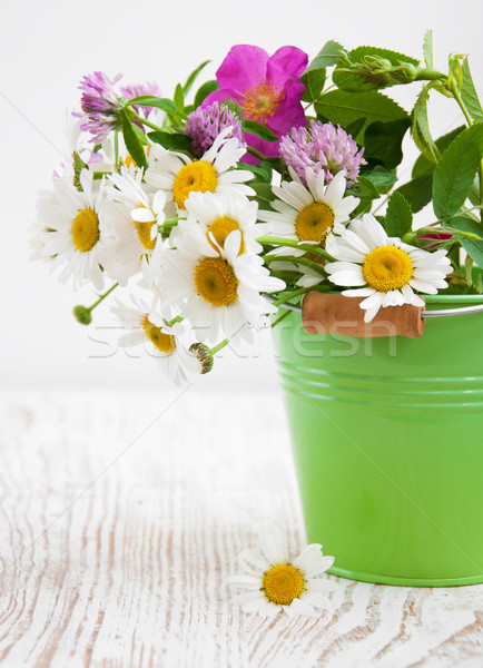 Bucket with wild flowers Stock photo © Es75