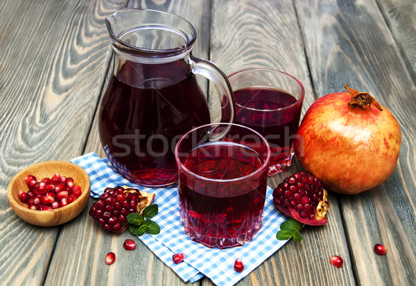 Pitcher and Two glasses of pomegranate juice Stock photo © Es75