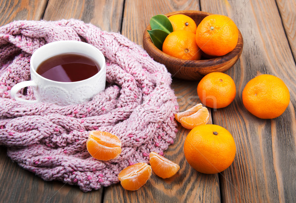 Cup of tea with scarf and tangerines Stock photo © Es75