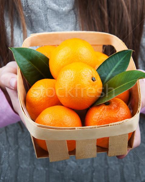 Panier mains fille fruits orange vert Photo stock © Es75