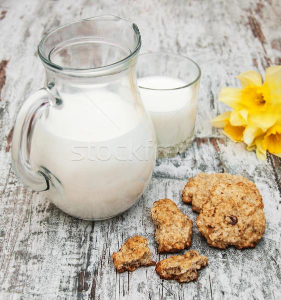 Brocca latte cookies vecchio legno Foto d'archivio © Es75
