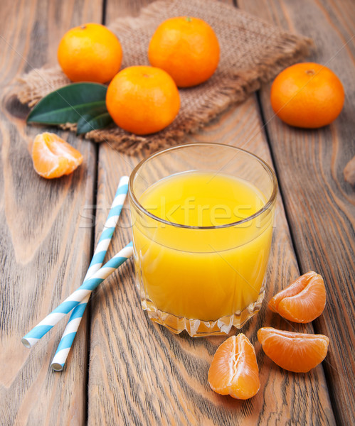 Fresco cítrico suco laranja velho mesa de madeira Foto stock © Es75
