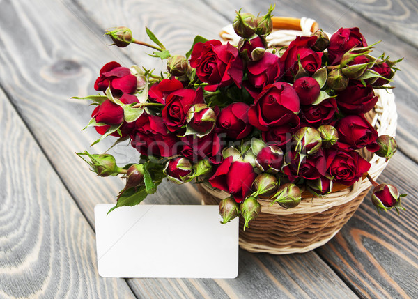 Red roses in basket and greeting card Stock photo © Es75