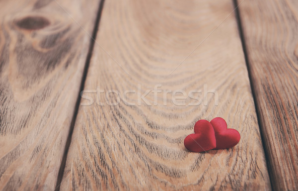 Hearts on a wooden background - vintage toning Stock photo © Es75