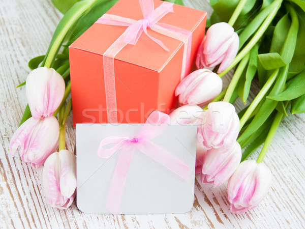 Bunch of tulips with present cart and gift box Stock photo © Es75