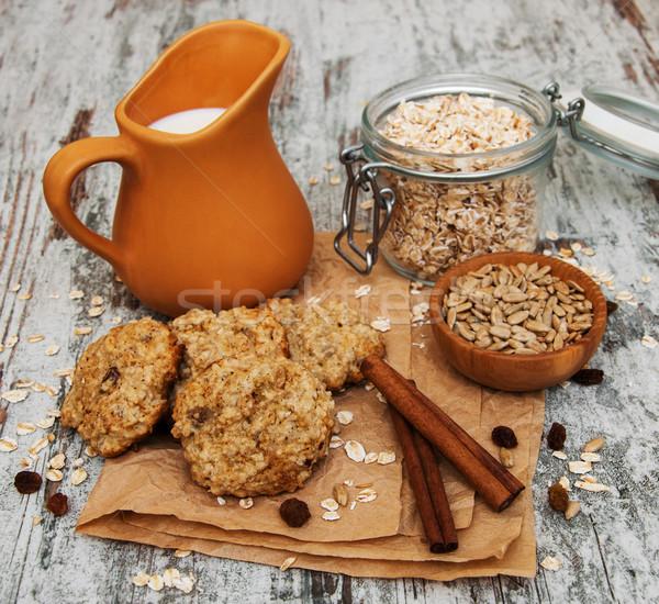 Kása sütik tej öreg fa asztal háttér Stock fotó © Es75