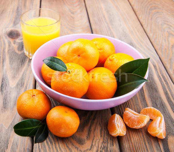 Friss citrus dzsúz narancs öreg fa asztal Stock fotó © Es75