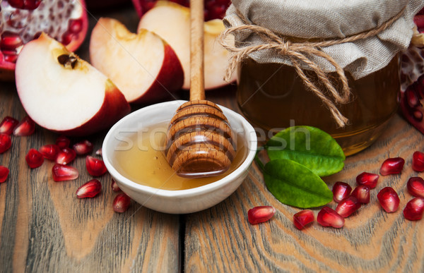 Honey with pomegranate and apples Stock photo © Es75