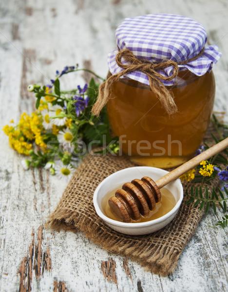 Méz vad virágok öreg fából készült étel fa Stock fotó © Es75