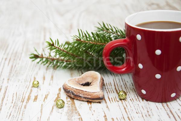 Karácsony cappucchino csésze ünnep csokoládé piros Stock fotó © Es75