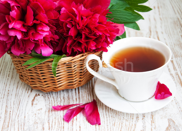 Tea with   pink peonies  Stock photo © Es75