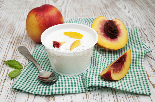 Yougurt with peaches Stock photo © Es75