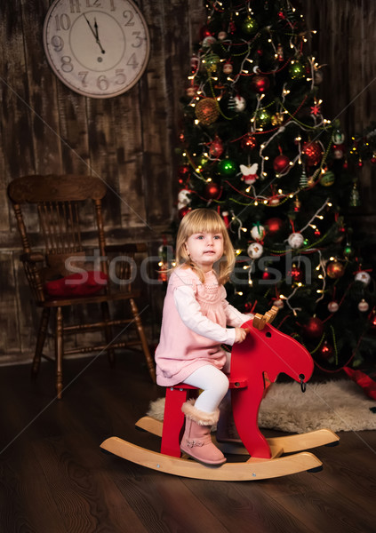little girl on a toy horse Stock photo © Es75