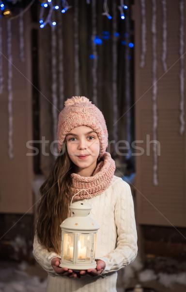 Joli petite fille lampe de poche Noël temps bébé Photo stock © Es75