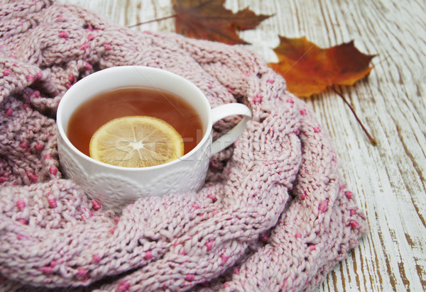 Cup of hot tea with lemon and scarf Stock photo © Es75