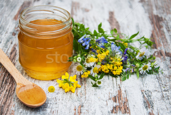 Miele fiori di campo vecchio legno alimentare legno Foto d'archivio © Es75