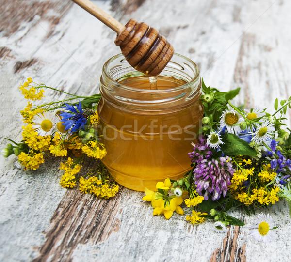 Honey and wild flowers Stock photo © Es75
