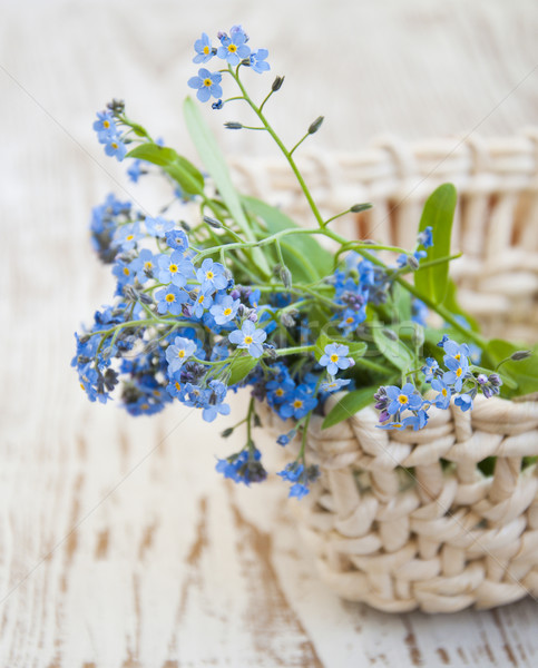 Bouquet of spring flowers in basket Stock photo © Es75