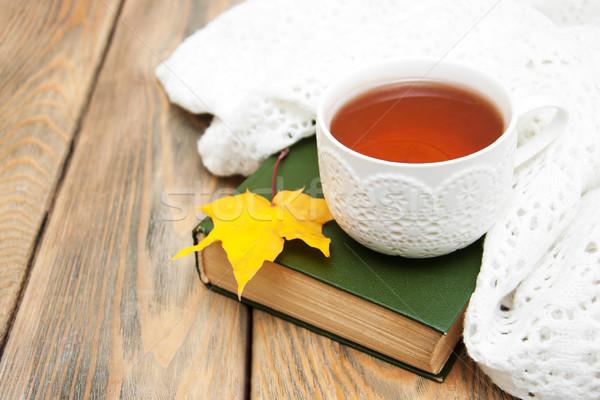Copo chá velho livro cachecol outono folha Foto stock © Es75