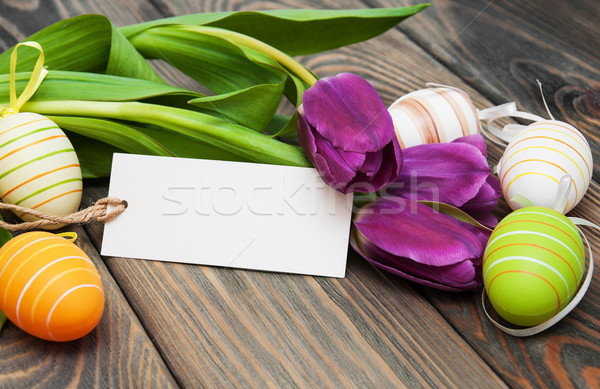 easter background with easter eggs and tulips Stock fotó © Es75