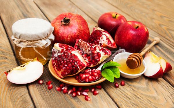 Honing granaatappel appels oude houten voedsel Stockfoto © Es75
