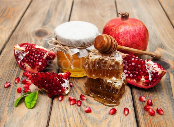 Honing granaatappel oude houten voedsel vruchten Stockfoto © Es75