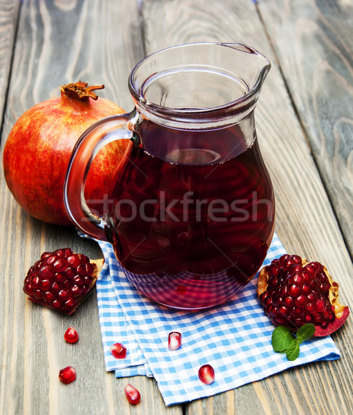 Pitcher of pomegranate juice Stock photo © Es75
