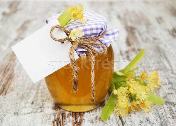 jar of honey and linden flowers Stock photo © Es75
