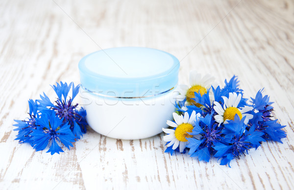 Stock photo: container with cream  and cornflowers